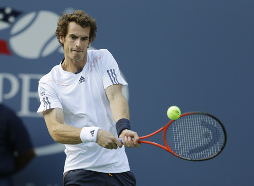 Britain's Andy Murray returns a shot to Serbia's Novak Djokovic during the championship match at the 2012 US Open tennis tournament,  Monday, Sept. 10, 2012, in New York. (AP Photo/Darron Cummings)
