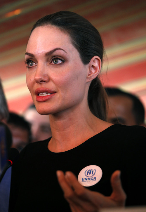 The U.N. refugee agency's special envoy, actress Angelina Jolie speaks to the press during her visit to the Zaatari Syrian Refugees Camp, in Mafraq, Jordan, Tuesday, Sept. 11, 2012. The Hollywood star arrived on Tuesday morning in the Zaatari camp, which hosts about 27,000 Syrians displaced by the 18-month conflict. (AP photo/Mohammad Hannon)