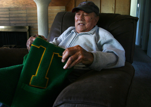 Steve Griffin |  The Salt Lake Tribune George Murakami holds his varsity sweater as he talks about his time in Topaz, the internment camp for Japanese Americans northwest of Delta, from his home in Rose Park, Utah Tuesday September 4, 2012. Murakami graduated from the camp high school in 1944 -- and promptly caught a train bound for a job at the University of Michigan.