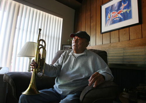 Steve Griffin | The Salt Lake Tribune George Murakami holds the bugle he played as a young man in Topaz, the internment camp for Japanese Americans northwest of Delta, from his home in Rose Park, Utah Tuesday September 4, 2012.