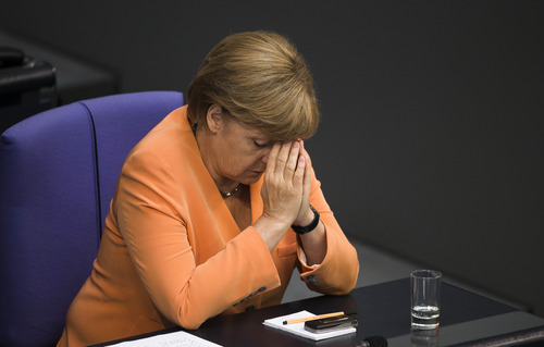 German Chancellor Angela Merkel attends the the first session of the budget 2013 debate at the parliament Bundestag in Berlin, Germany, Tuesday, Sept. 11, 2012. On Wednesday Merkel and her government face a rule of Germany's Federal Constitutional Court about the legitimacy of the European Stability Mechanism and the  Fiscal Compact for Germany. (AP Photo/Markus Schreiber)