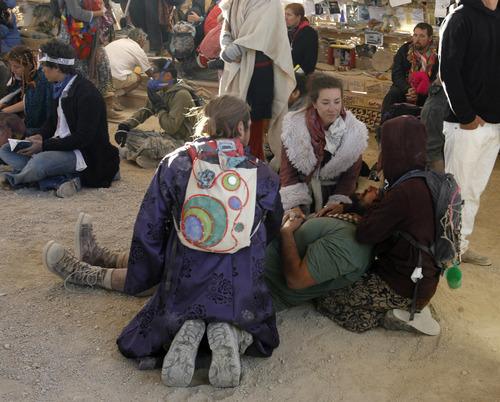 Rick Egan  | The Salt Lake Tribune   Burning Man participants console each other, at the
