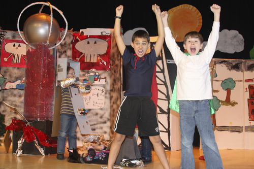 Bonneville students Gavin Nielson, Carter Olson and Edward Sanderson celebrate the defeat of Dr. Uranium in their