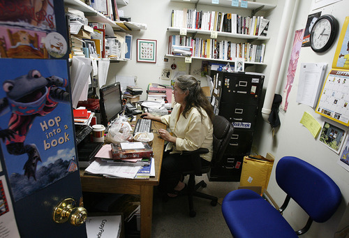Scott Sommerdorf     The Salt Lake Tribune              Anne Holman in her office -- which used to be the men's restroom in the gas station that pre-dated The King's English Bookshop -- at the store now celebrating its 35th year in business at 1511 S. 1500 East, Salt Lake City.