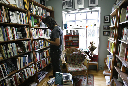 Scott Sommerdorf     The Salt Lake Tribune              Customer Fernando Ramos examines a book at The King's English Bookshop on Sept. 6, 2012. The independent bookstore is marking its 35th anniversary with a party and sale on Sept. 10.