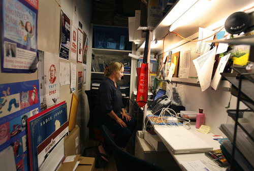 Scott Sommerdorf     The Salt Lake Tribune              Marketing manager Jenny Lyons works in the closet-sized office she shares with a colleague at The King's English Bookshop on Sept. 6, 2012. The store is celebrating its 35th year in business.