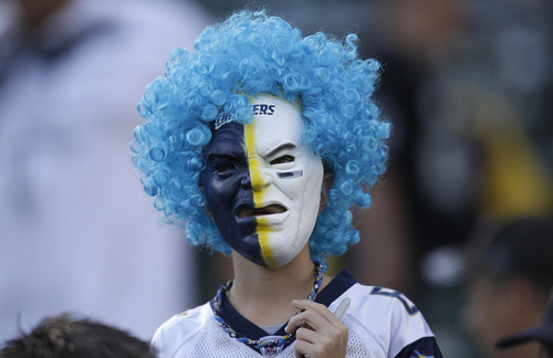 A San Diego Chargers fan is shown before an NFL football game between the Oakland Raiders and the San Diego Chargers in Oakland, Calif., Monday, Sept. 10, 2012. (AP Photo/Ben Margot)