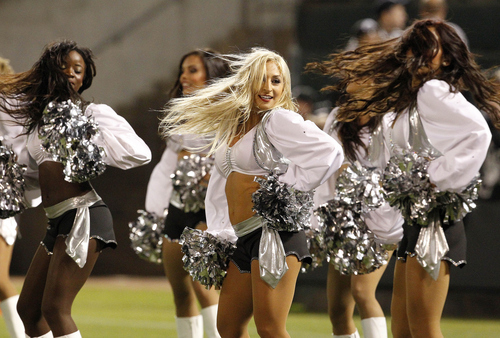 Oakland Raiders cheerleaders perform during the first half of an NFL football game against the San Diego Chargers in Oakland, Calif., Monday, Sept. 10, 2012. (AP Photo/Tony Avelar)