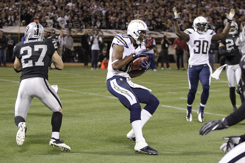 San Diego Chargers wide receiver Malcom Floyd (80) catches a touchdown pass from quarterback Philip Rivers during the second quarter of an NFL football game against the Oakland Raiders in Oakland, Calif., Monday, Sept. 10, 2012. (AP Photo/Ben Margot)