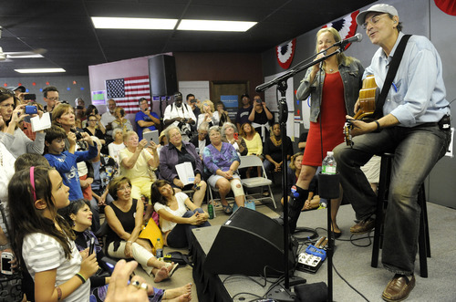 Musician James Taylor and wife Kim perform at OFA-MI Royal Oak Grassroots Headquarters in Royal Oak, Mich., Sunday, Sept, 9, 2012. Taylor also sang at last week's Democratic National Convention in Charlotte, N.C. Obama supporters are enlisting new volunteers heading into the final weeks of the 2012 presidential campaign. (AP Photo/The Detroit News, David Coates)