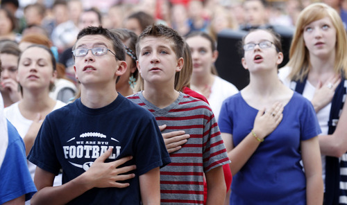 Al Hartmann  |  The Salt Lake Tribune Students recite the Pledge of Allegiance after raising the American flag in a Sunrise Salute to Patriots at South Jordan Middle School on Tuesday. Students sang a number of patriotic songs as they  gathered around the flag pole in a tribute to 9/11 victims.