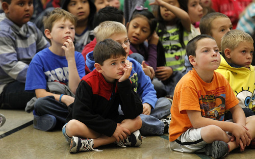 Al Hartmann  |  The Salt Lake Tribune Wasatch Elementary students listen to Utah Lt. Gov. Greg Bell speak during a special flag presentation at the Clearfield school on Tuesday. An American flag that has flown over the USS Arizona at Pearl Harbor, Hill Air Force Base and the U.S. Capitol was presented to the school.