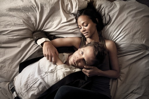 This film image released by CBS Films shows Bradley Cooper and Zoë Saldana in a scene from