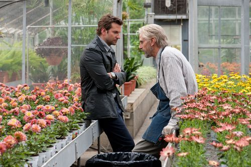 This film image released by CBS Films shows Bradley Cooper and Jeremy Irons in a scene from