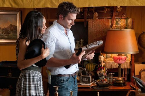 This film image released by CBS Films shows Bradley Cooper, right, and Zoë Saldana in a scene from