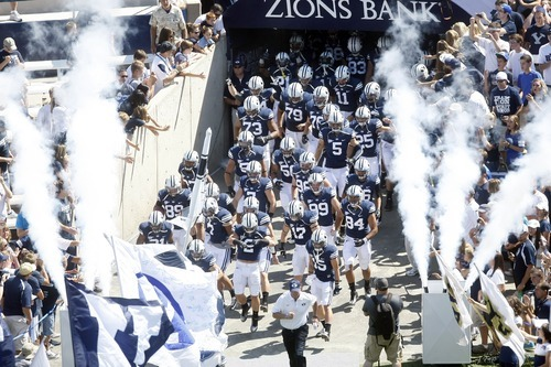 Chris Detrick  |  The Salt Lake Tribune Members of the BYU football team run onto the field before the game against Weber State at LaVell Edwards Stadium Saturday September 8, 2012.