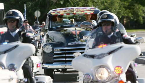 Steve Griffin | The Salt Lake Tribune   Dave Vinnedge, father of Lance Corporal Phillip David Vinnedge, who died while serving in Afghanistan, is escorted by West Valley City police as he drives a vintage truck he, and his wife, Julie Vinnedge, restored in honor of their son during an event at Fairbourne Station Plaza, in West Valley City, Utah Tuesday September 11, 2012. The Vinnedge's fulfilled his dream of restoring a 1951 Chevy truck complete with murals honoring him, his family, his military colleagues and those lost on September 11, 2001. Lance Cpl. Vinnedge's parents now travel and display the truck in memory of their son. They will be in Camp Pendleton Sept. 13, 2012 to show the truck to his son's platoon. Phillip was deployed with the 3rd Battalion, 5th Marine Regiment to Afghanistan and on October 13, 2010 Phillip was driving the lead vehicle on a security patrol with Lcpl Victor Dew, Lcpl Joe Rodewald and Cpl Justin Cain when a large IED was remotely detonated killing all 4 instantly.