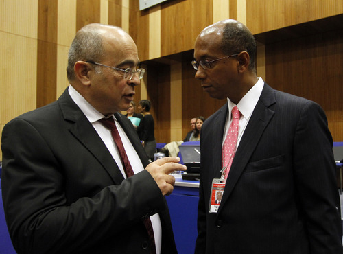 Israel's Ambassador to the International Atomic Energy Agency, IAEA, Ehud Azoulay, talks with U.S. Alternate Permanent Representative to the United Nations Robert Wood, from left, at the start of the IAEA board of governors meeting at the International Center in Vienna, Austria, Wednesday, Sept. 12, 2012. (AP Photo/Ronald Zak)