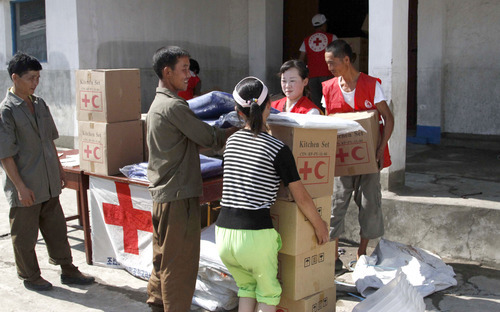 FILE - In this Aug. 4, 2012 file photo, residents collect emergency goods, including kitchen sets and blankets, distributed by North Korean Red Cross officials in the flood-stricken city of Anju in South Phyongan Province, North Korea.  South Korea said North Korea has rejected its offer of food and medical supplies to help flood victims. South Korea on Tuesday, Sept. 11, 2012, proposed providing 10,000 tons of flour, 3 million packages of ramen noodles and medical supplies. Seoul's Unification Ministry said North Korea's Red Cross replied Wednesday, Sept. 12, 2012, it doesn't need the assistance offered. (AP Photo/Kim Kwang Hyon, File)