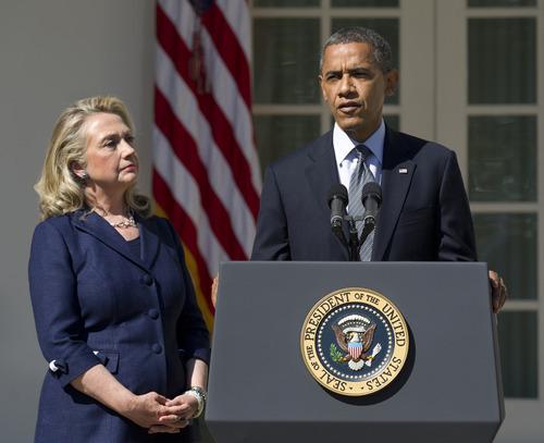 President Barack Obama, with Secretary of State Hillary Rodham Clinton, speaks in the Rose Garden of the White House in Washington, Wednesday, Sept. 12, 2012.  (AP Photo/Manuel Balce Ceneta)