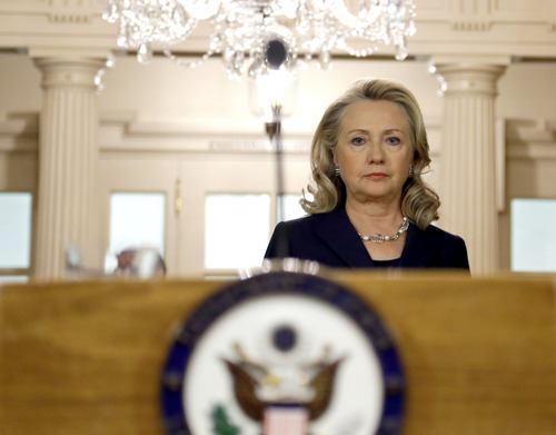Secretary of State Hillary Rodham Clinton arrives to speak at the State Department in Washington Wednesday, Sept. 12, 2012, on the recent deaths of Americans in Libya. (AP Photo/Alex Brandon)
