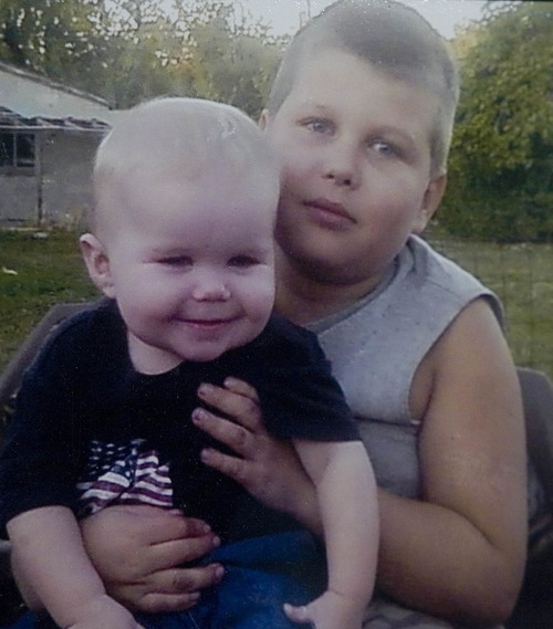 Paul Fraughton   The Salt Lake Tribune A photo of David Rayborn taken when he was 11 years old. He is holding his younger brother Killian who was age 2 at the time.   Tuesday, September 11, 2012