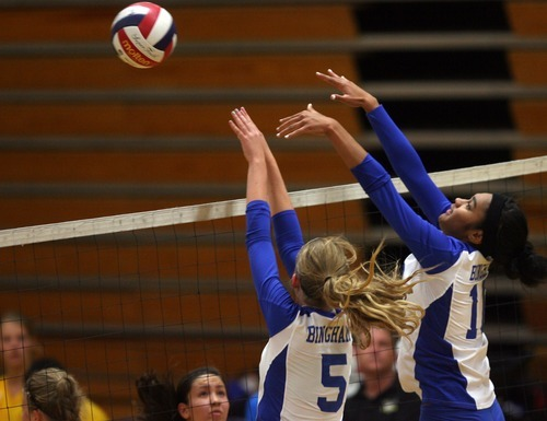 Kim Raff | The Salt Lake Tribune Bingham defenders Megan Boudreaux, left, and Talia Afalava try to block the ball hit by Taylorsville during a match at Taylorsville High School in Taylorsville.