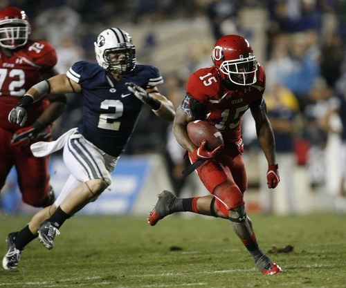 Trent Nelson  |  The Salt Lake Tribune Utah's John White runs for a touchdown against BYU during the 2011 rivalry game in Provo.