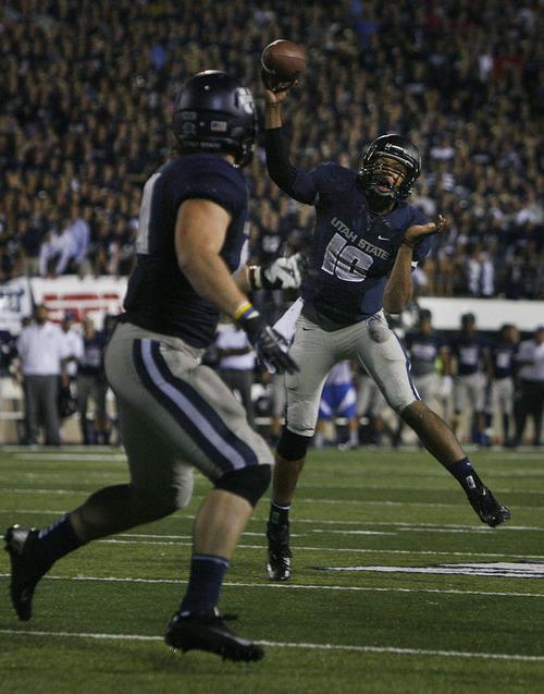 Scott Sommerdorf  |  The Salt Lake Tribune              USU QB Chuckie Keeton throws a four yard TD pass to Kellen Bartlett to give USU a late 20-13 lead. The USU Aggies beat Utah 27-20 in OT, Friday, September 7, 2012.