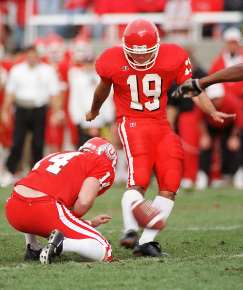 Utah kicker Ryan Kaneshiro kicks what would be a game-winning field goal, until it hit the upright and bounced out giving BYU the victory in 1998. Courtesy of University of Utah Athletics