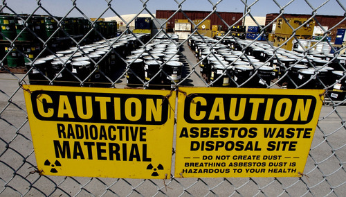 Tribune file photo Barrels of hazardous waste waiting to be disposed of in the EnergySolutions disposal site in Tooele County. State oversight of radiocative waste came under criticism in a legislative audit released Tuesday.