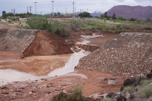 Kyle Kester | Special to the Tribune What remains of Santa Clara's dike located behind Snow Canyon High School after Tuesday's breach.