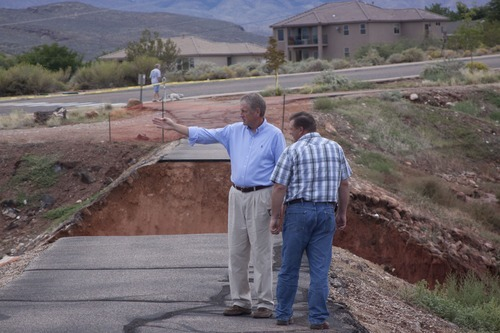 Kyle Kester | Special to the Tribune From left to right, Rick Whittington a Santa Clara business owner and Kurt Vest a State Engineer survey the damage to the Santa Clara dike that broke Tuesday afternoon.