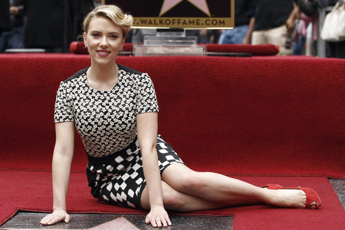 (AP Photo/Matt Sayles) Actress Scarlett Johansson, at a ceremony marking her inclusion on the Hollywood Walk of Fame, is among the celebrities who have had pictures or video of themselves land on the Internet unexpectedly.
