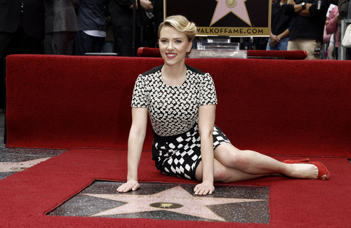 Actress Scarlett Johansson poses for photographers after receiving a star on the Hollywood Walk of Fame in Los Angeles, Wednesday, May 2, 2012.  Johansson stars in the upcoming film