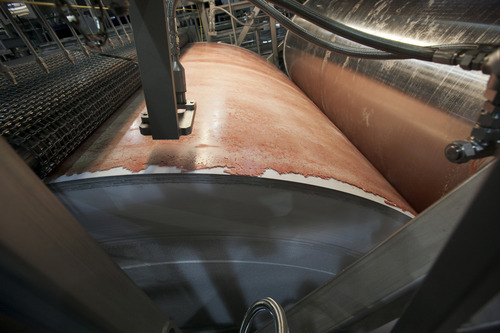 (AP Photo/Nati Harnik, File) The product lean, finely textured beef, popularly known as pink slime, is frozen on a large drum as part of its manufacturing process at the Beef Products Inc.'s plant in South Sioux City, Neb.
