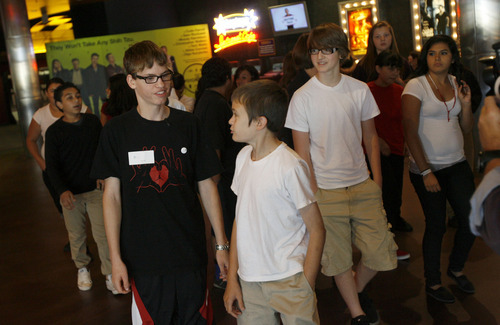 Francisco Kjolseth  |  The Salt Lake Tribune Alex Libby, 15, center left, walks out of The Gateway theaters with Bryant Middle School students after a screening of the documentary film