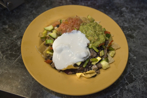 Paul Fraughton | The Salt Lake Tribune The deluxe half and half nachos with steak and roasted vegetables at Mountain West Burrito in Provo.