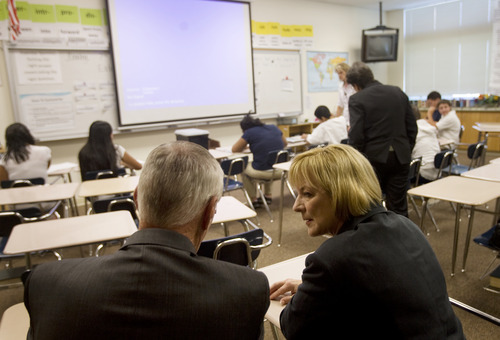 Kim Raff   The Salt Lake Tribune (right) Deb Delisle, Assistant Secretary with the U.S. Department of Education, talks with State Superintendent Larry Shumway in an 8th grade reading class during a tour of Glendale Middle School, one of many stops on the Education Department's 2012 cross-country, back-to-school bus tour,