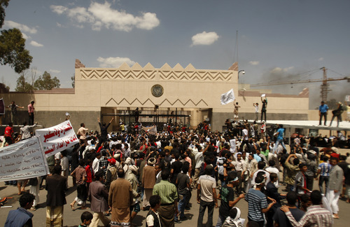 Yemenis protest in front of the U.S. Embassy about a film ridiculing Islam's Prophet Muhammad, in Sanaa, Yemen, Thursday, Sept. 13, 2012. Dozens of protesters gather in front of the US Embassy in Sanaa to protest against the American film