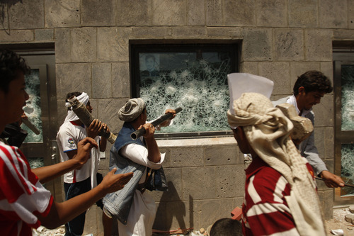 Yemeni protesters break a window of the U.S. Embassy during a protest about a film ridiculing Islam's Prophet Muhammad, in Sanaa, Yemen, Thursday, Sept. 13, 2012. Dozens of protesters gather in front of the US Embassy in Sanaa to protest against the American film