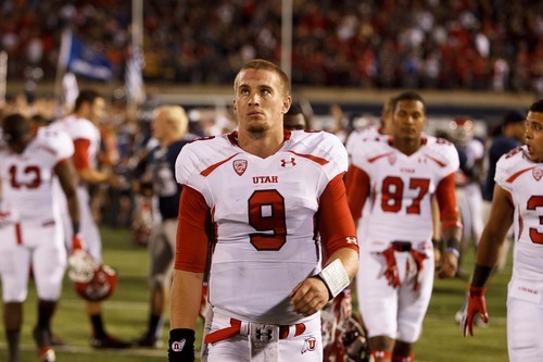 Trent Nelson  |  The Salt Lake Tribune Utah quarterback Jon Hays walks off the field after the overtime loss against Utah State in Logan on Sept. 7, 2012.