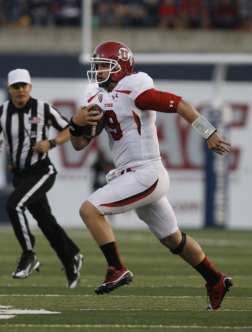Scott Sommerdorf  |  The Salt Lake Tribune              Utah QB Jon Hays scrambles for yardage late in the first half. The drive resulted in Utah's only points - a FG - prior to halftime. The USU Aggies held a 13-3 lead over Utah at the half, Friday, September 7, 2012.