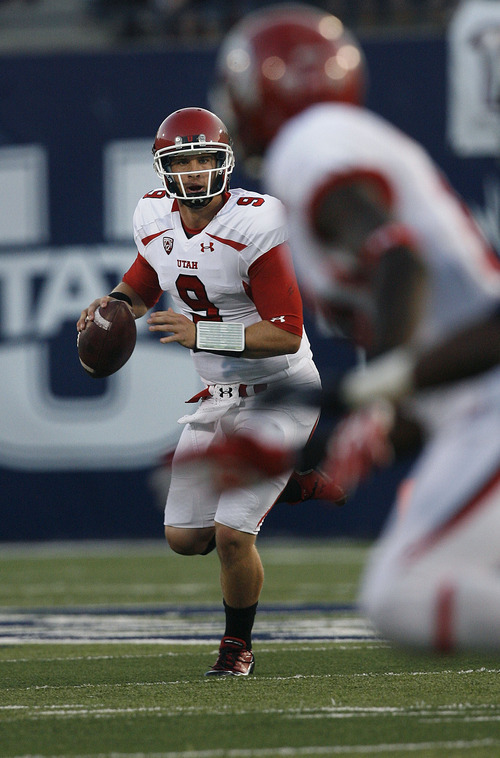 Scott Sommerdorf  |  The Salt Lake Tribune              Utah QB Jon Hays looks for an open receiver late in the first half. The USU Aggies held a 13-3 lead over Utah at the half, Friday, September 7, 2012.
