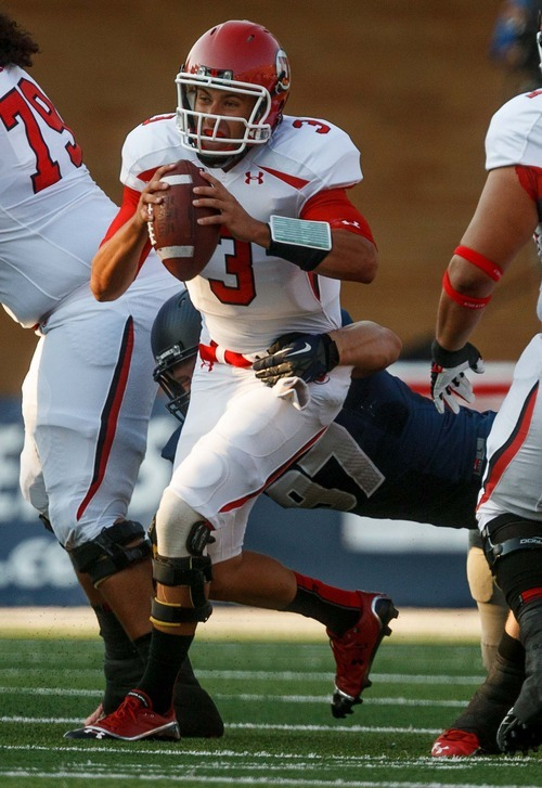 Trent Nelson  |  The Salt Lake Tribune Utah quarterback Jordan Wynn is sacked by Utah State's  during the first quarter as Utah State hosts the University of Utah, college football in Logan, Utah, Friday, September 7, 2012.
