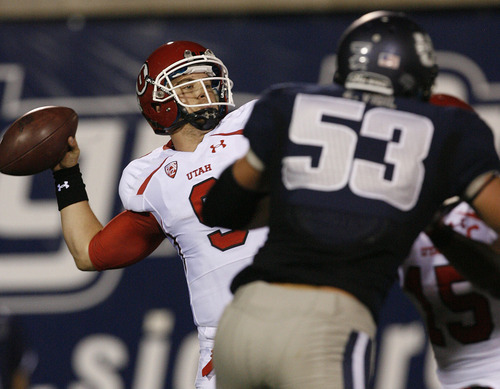 Scott Sommerdorf  |  The Salt Lake Tribune              Utah QB Jon Hays throws during second half play. He finished 12 for 26 and a TD after replacing Jordan Wynn. The USU Aggies beat Utah 27-20 in OT, Friday, September 7, 2012.