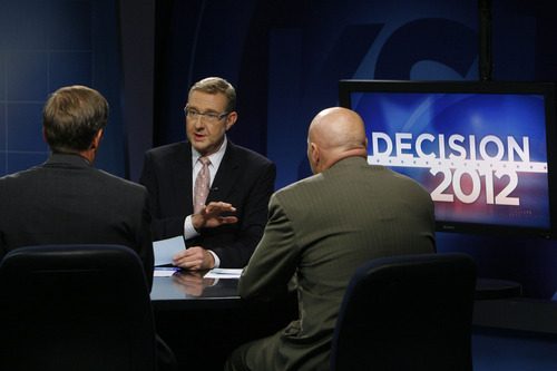 Francisco Kjolseth  |  The Salt Lake Tribune KSL reporter Rich Piatt, center, conducts the first debate between 2nd Congressional District candidates Chris Stewart, left, and Jay Seegmiller on Thursday, September 13, 2012.