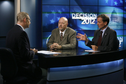 Francisco Kjolseth  |  The Salt Lake Tribune KSL reporter Rich Piatt, left, conducts the first debate between 2nd Congressional District candidates Jay Seegmiller, center, and Chris Stewart on Thursday, September 13, 2012.