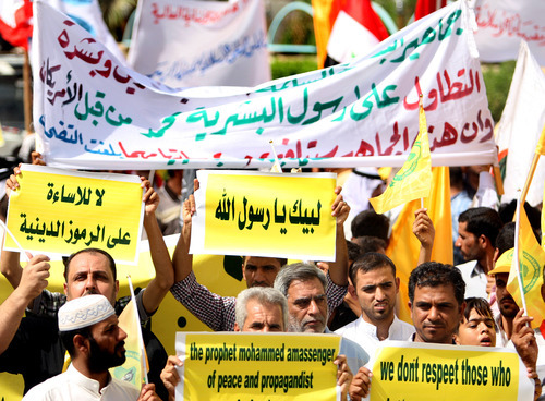 Iraqis chant slogans during a protest in Basra, 340 miles (547 kilometers) southeast of Baghdad, Iraq, Friday, Sept. 14, 2012. In Basra, about 1,000 Iraqis marched the streets and burned the American and Israeli flags.