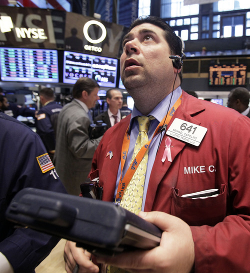 (AP Photo/Richard Drew) The NYSE and its parent NYSE Euronext agreed in the settlement to hire an independent consultant to review their systems for delivering market data.